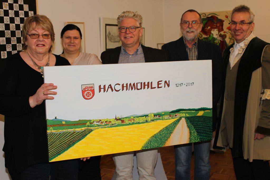 Bärbel Bohlmann mit ihrem Bild zum Dorfjubiläum, Ortsrätin Claudia Weißflog-Borgwardt, Stefan Lampe, Jürgen Bohlmann (nach dessen Foto entstand das Malwerk) und Hartwig Möller